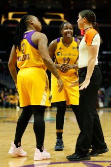 Chelsea Gray discusses a call with an official while Riquna Williams listens in. Photo by Maria Noble/WomensHoopsWorld.