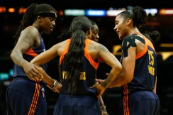 Connecticut Sun players confer at a timeout. Photo by Maria Noble/WomensHoopsWorld.