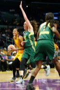 Candace Parker drives against Breanna Stewart. Photo by Maria Noble/WomensHoopsWorld.