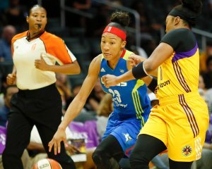 Aerial Powers is defended on the drive by Odyssey Sims. Photo by Maria Noble/WomensHoopsWorld.