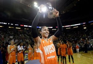 Minnesota Lynx's Maya Moore, of the Western Conference, holds up a trophy after being named most valuable player as teammates cheer behind after the WNBA All-Star basketball game Saturday, July 22, 2017, in Seattle. AP Photo/Elaine Thompson.