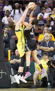 Breanna Stewart blocks Dearica Hamby's shot.  Photo by Neil Enns/Storm Photos.