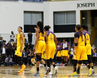 Candace Parker shares a laugh with teammates. Photo by Maria Noble/WomensHoopsWorld.