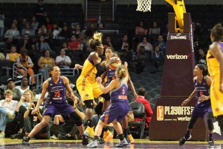 Essence Carson goes up to score. Photo by Benita West/TGSportsTV1.