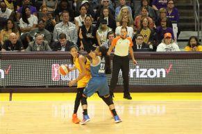 Candace Parker battles to pass around Maya Moore. Photo by Benita West/TGSportsTV1.