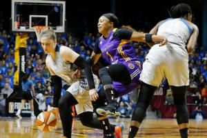 Odyssey Sims tries to squeeze past Sylvia Fowles, in pursuit of Lindsay Whalen, in the first half of Game 2. Photo by Jim Mone/AP.