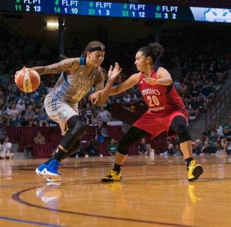 Kristi Toliver defends Seimone Augustus. Photo by Brian Few Jr./TGSportsTV1.