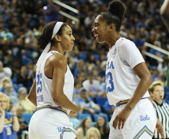 Monique Billings and Kelli Hayes share a moment. Photo by Maria Noble/WomensHoopsWorld.