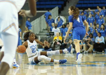 Kennedy Burke retains ball possession. Photo by Maria Noble/WomensHoopsWorld.