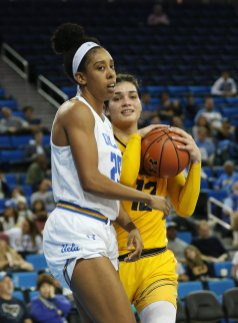 Monique Billings and Penina Davidson as a whistle is blown. Photo by Maria Noble/WomensHoopsWorld.