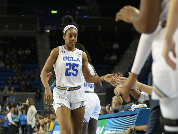 Monique Billings is greeted as she leaves the floor. Photo by Maria Noble/WomensHoopsWorld.