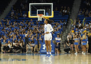 Kelli Hayes jumps in excitement as the Bruin lead climbs late in the game. Photo by Maria Noble/WomensHoopsWorld.