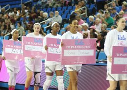 UCLA players in the pre-game Play4Kay walk. Photo by Maria Noble/WomensHoopsWorld.