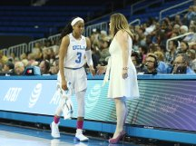 Coach Cori Close talks to Jordin Canada as she comes out of the game. Photo by Maria Noble/WomensHoopsWorld.