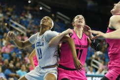Lajahna Drummer and Robbi Ryan box each other out. Photo by Maria Noble/WomensHoopsWorld.