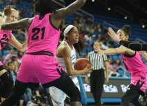 Jordin Canada looks for an outlet in being defended. Photo by Maria Noble/WomensHoopsWorld.