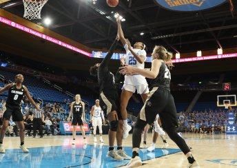 Monique Billings goes up over Zoe Correal to make the shot. Photo by Maria Noble/WomensHoopsWorld.