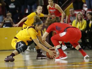 ASU's Kianna Ibis and Arizona's Lucia Alonso fight for ball control. Photo by Patrick Breen.