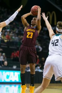 Kenisha Bell shoots over the Green Bay defense. Photo by Courtney Anderson.