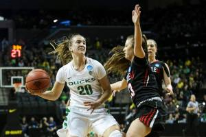 Sabrina Ionescu looks to pass out of a defensive trap. Photo by Eric Evans Photography.