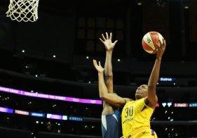 Nneka Ogwumike tries to score on Sylvia Fowles. Maria Noble/WomensHoopsWorld.