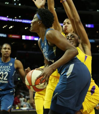 Sylvia Fowles is defendd by Nneka Ogwumike and Candace Parker. Maria Noble/WomensHoopsWorld.