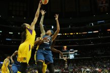 Candace Parker swats the ball away from Seimone Augustus. Maria Noble/WomensHoopsWorld.