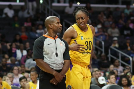 Nneka Ogwumike talks to a ref about a call. Photo by Maria Noble/WomensHoopsWorld.
