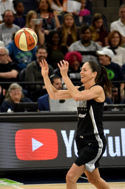 Storm veteran Sue Bird smiles as she passes the ball in her WNBA record 11th All-Star Game appearance. Maggi Stivers/WomensHoopsWorld.