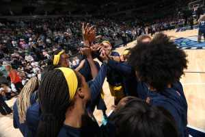 The Indiana Fever huddle before tipff last month. Photo courtesy of Indiana Fever/NBAE via Getty Images.