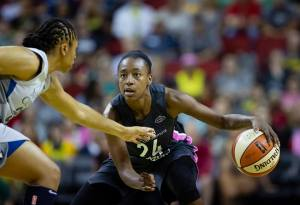 Jewell Loyd looks for passing option while guarded by Tanisha Wright. Lindsey Wasson/Seattle Storm.