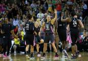 Sue Bird high-fives Jewell Loyd during the Storm's scoring surge in the second half. Lindsey Wasson/Seattle Storm.