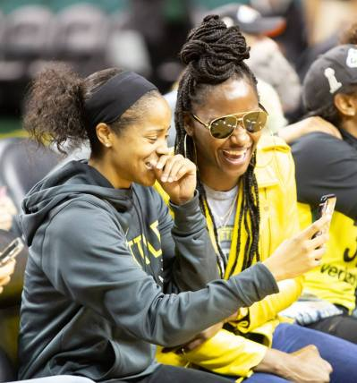 Jordin Canada and Crystal Langhorne laugh as they are on social media during the event. Neil Enns/Storm Photos.