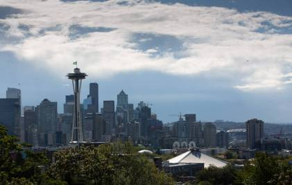 The Seattle Storm flag flies atop the Space Needle. Neil Enns/Storm Photos.