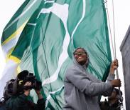 Noelle Quinn takes a turn hoisting the flag. Neil Enns/Storm Photos.