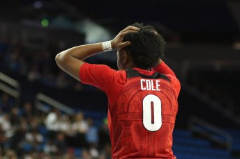 Taja Cole reacts as the Bulldogs fall further behind. Maria Noble/WomensHoopsWorld.
