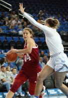 Ali Patberg drives to the basket. Photo by Maria Noble/WomensHoopsWorld.
