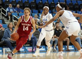 Ali Patberg completes the fast break play. Photo by Maria Noble/WomensHoopsWorld.