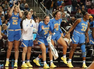 The Bruin bench applauds after another bucket in the third period. Maria Noble/WomensHoopsWorld.
