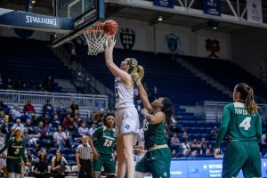 Nancy Mulkey powers in a layup. Photo by Juan DeLeon Studio/Rice Athletics.