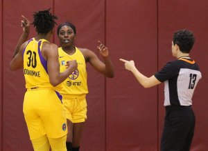Friday, May 17, 2019 - Nneka and Chiney Ogwumike consult. Maria Noble/WomensHoopsWorld.