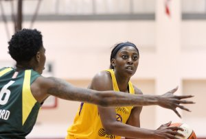 Friday, May 17, 2019 - Chiney Ogwumike tries to pass around Natasha Howard. Maria Noble/WomensHoopsWorld.