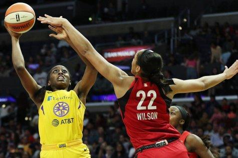 Chiney Ogwumike shoots over A'ja Wilson. Maria Noble/WomensHoopsWorld.