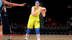 Megan Gustafson scans the court. NBAE/Getty Images photo.