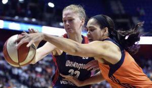 Emma Meesseman battles Brionna Jones for ball possession. NBAE/Getty Images photo.