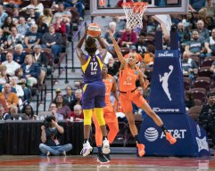 Los Angeles Sparks guard Chelsea Gray (12) shoots as Connecticut Sun guard Jasmine Thomas (5) defends during the WNBA Semi-Finals between the Los Angeles Sparks and the Connecticut Sun at Mohegan Sun Arena, Uncasville, Connecticut, USA on September 19, 2019. Photo Credit: Chris Poss