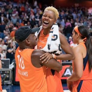 Connecticut Sun guard Courtney Williams (10) and her Don Williams after the WNBA Semi-Finals between the Los Angeles Sparks and the Connecticut Sun at Mohegan Sun Arena, Uncasville, Connecticut, USA on September 19, 2019. Photo Credit: Chris Poss