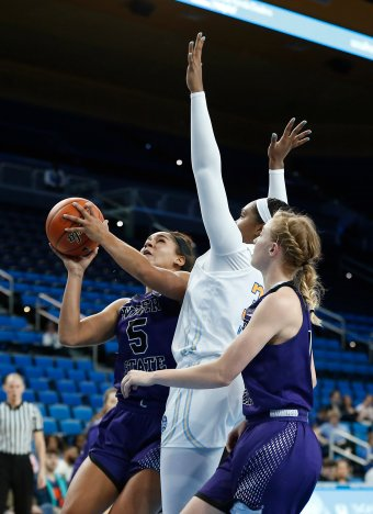 Weber State tries to break through the UCLA defense. Maria Noble/WomensHoopsWorld