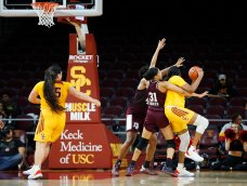 The Aggie defense locks down the Trojans. Maria Noble/WomensHoopsWorld