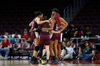 The Aggies huddle after a timeout. Maria Noble/WomensHoopsWorld